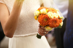 Gorgeous stylish elegant bride and groom holding colorful bouque Stock Images