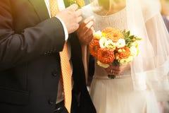 Gorgeous stylish elegant bride and groom holding colorful bouque Royalty Free Stock Photo