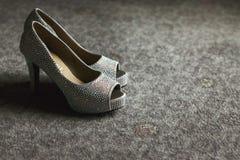 Gorgeous stylish elegant grey wedding shoes wth metal fragments Stock Photos