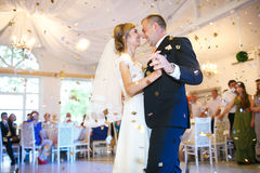 Gorgeous stylish happy bride and groom performing their emotiona Royalty Free Stock Photography