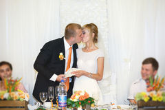 Gorgeous stylish happy bride and groom standing at centerpiece t Stock Photos