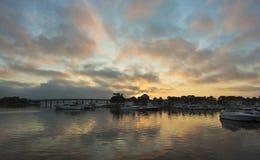 A Gorgeous Sunrise Over a Bridge and Marina Royalty Free Stock Image