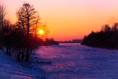 gorgeous sunset on the banks of the River kototoraya pokryda ice and snow Stock Photos