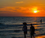 Gorgeous Sunset behind the Silhouette of beach goers at Indian Rocks Beach on the Gulf of Mexico in Florida. Stock Photos