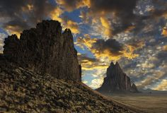 A Gorgeous Sunset Over a Shiprock Horizon. A Gorgeous Sunset of Blue and Gold Over a Shiprock, New Mexico, Horizon Royalty Free Stock Images