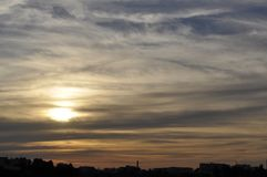 Gorgeous sunset strata cloudscape. Magical view of gorgeous sunset over cityscape stock image