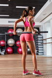 Gorgeous suntanned brunette doing exercises stock photography