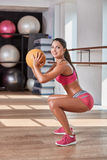 Gorgeous suntanned brunette doing exercises Royalty Free Stock Images