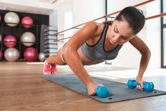 Gorgeous suntanned brunette doing exercises Stock Images