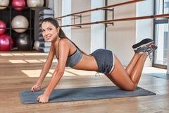 Gorgeous suntanned brunette doing exercises Royalty Free Stock Photo