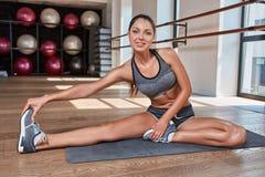 Gorgeous suntanned brunette doing exercises Stock Photography