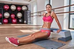 Gorgeous suntanned brunette doing exercises Stock Photo