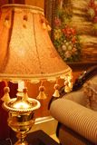 Gorgeous table lamp. In a sitting room Royalty Free Stock Photos