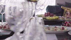 Gorgeous table with wine glasses and food closeup