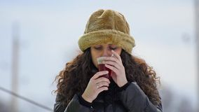 Gorgeous teen with fur hat drinking hot tea Stock Photography