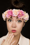Gorgeous teen girl wearing floral crown surprised expression Stock Images
