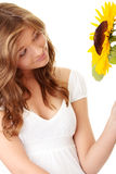 Gorgeous teenage female. Holding yellow sunflower over white background Royalty Free Stock Image