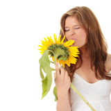 Gorgeous teenage female. Holding yellow sunflower over white background Stock Images