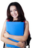 Gorgeous teenage girl with bag and folder Royalty Free Stock Photography