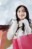 Gorgeous teenage girl holding shopping bags Royalty Free Stock Images