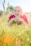 Gorgeous teenage girl smiling in the grass, instagram effects Stock Image