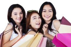 Gorgeous teenage shopaholics smiling Stock Photo