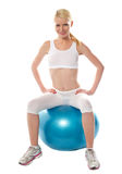 Gorgeous teenager sitting on exercise ball Stock Photography