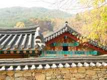 Gorgeous and Unique Korean Traditional Style Roofs and Stone Wall of the Old Temple Stock Photography