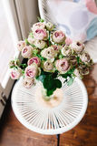 Gorgeous vase of vintage pink roses Royalty Free Stock Image