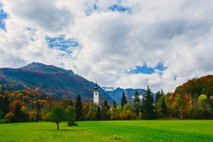 Gorgeous view of colorful autumnal scene of famous Church of St John the Baptist at Bohinj Lake Stock Images