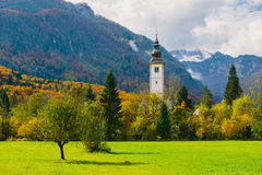 Gorgeous view of colorful autumnal scene of famous Church of St John the Baptist at Bohinj Lake Stock Image