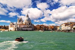 Basilica Santa Maria della Salute during a beautiful day, Venice, Italy. Gorgeous view of the Grand Canal and Basilica Santa Maria della Salute during a royalty free stock image