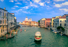 Gorgeous view of the Grand Canal and Basilica Santa Maria della Salute. During sunset with interesting clouds, Venice, Italy royalty free stock image