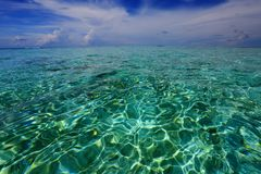 Gorgeous view of horizon line. Turquoise water of Indian Ocean and blue sky with white clouds. Amazing nature backgrounds. Maldives royalty free stock photography