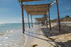 Gorgeous  view of the ocean and decorated beach walkway with people in background at Cuban island. Great amazing, inviting view of the ocean and decorated beach Royalty Free Stock Photos