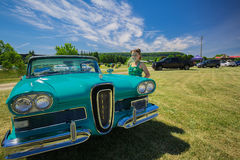 Gorgeous view of old vintage classic car with pretty smiled little girl standing beside Royalty Free Stock Photo