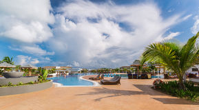 Gorgeous view of resort grounds, swimming pool with people relaxing and enjoying their time on sunny beautiful day. Cayo Guillermo island, Cuba, June 28, 2016 Stock Photo