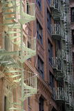 Gorgeous view of spiral staircases on city buildings Stock Photo