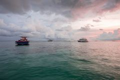 Gorgeous view of sunset on Indian Ocean, Maldives. Some boats on blue water and blue sky with white clouds background. Amazing nature landscape background stock images