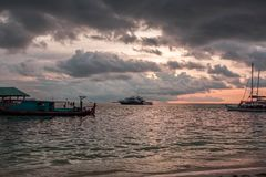Gorgeous view of sunset on Indian Ocean, Maldives. Some boats on horizon line. Amazing nature landscape background royalty free stock image