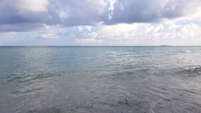 Gorgeous view of tropical landscape . White sand and light turquoise water with blue sky and white clouds. Time lapse. Maldives, Indian Ocean. Gorgeous view of stock footage