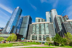 Gorgeous view of various condo and office stylish modern buildings against blue sky background Royalty Free Stock Images