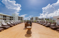 gorgeous view of various modern stylish outdoor patio furniture with sunbeds Royalty Free Stock Image