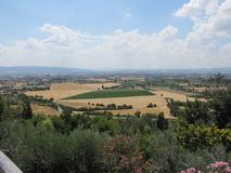 Gorgeous views of the surrounding landscape from the village of Assisi, Italy. The views from the village of Assisi, Italy are representative of this country`s Stock Photography
