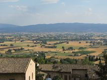 Gorgeous views of the surrounding landscape from the village of Assisi, Italy. The views from the village of Assisi, Italy are representative of this country`s Royalty Free Stock Photo