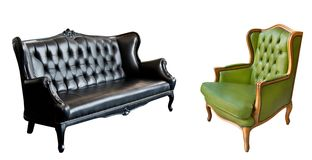 Gorgeous vintage green leather armchair and black leather sofa isolated on white background.  royalty free stock photos