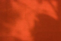 Gorgeous warm red wall. Grunge background of the warm orangy red textured wall Stock Image