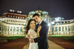 Gorgeous wedding couple background night city with castle in light royalty free stock photography