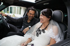 Gorgeous wedding couple in car Royalty Free Stock Image