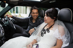 Gorgeous wedding couple in car Royalty Free Stock Photo